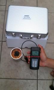 Untuk mengukur kadar air biji jagung dengan sistem tuang